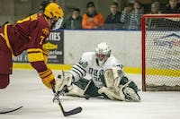 Ohio goalie Jimmy Thomas (#30) makes a save after a shot attempt from Iowa State forward Tony Uglem (#7) during the third period of the Bobcats' game against the Cyclones on Friday, Feb.15.