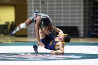 Ohio University's Shakur Laney wrestles against Kent State in a match on Jan. 18.