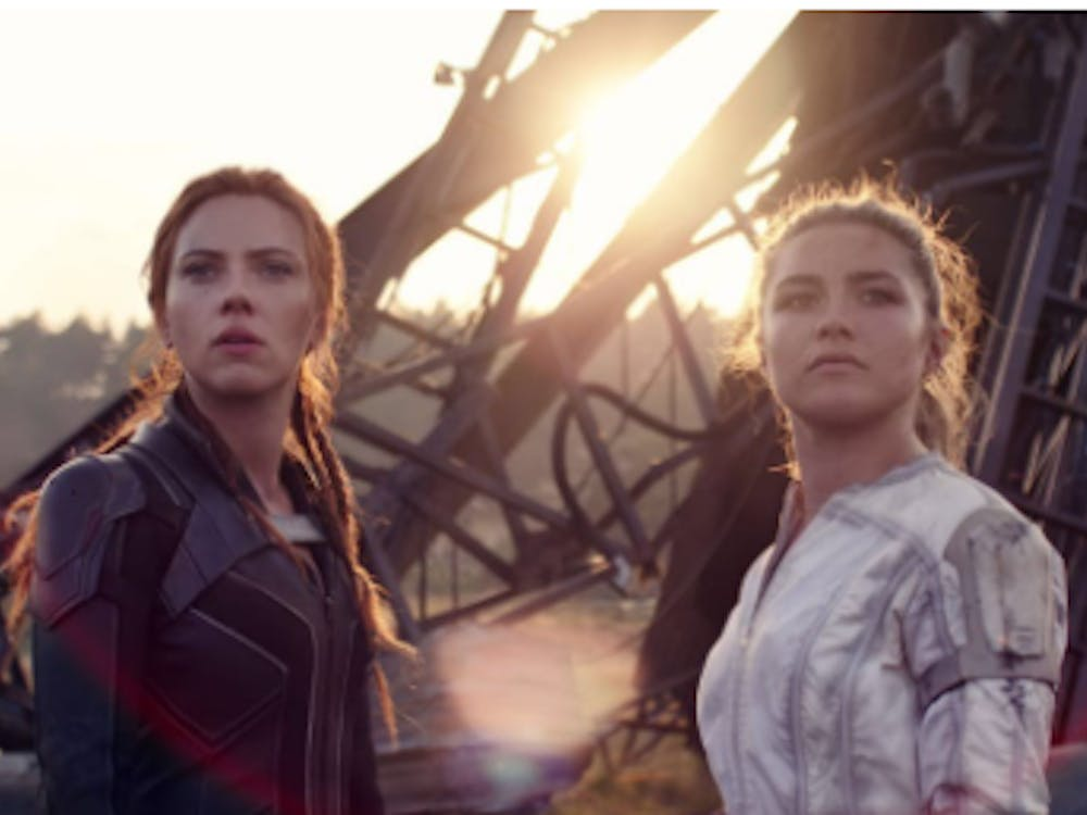 Scarlett Johansson and Florence Pugh stand triumphant following a battle in Black Widow, now in theaters and streaming on Disney + with premium access (Photo provided via @dorksofprey on Twitter).