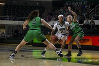 Ohio University guard CeCe Hooks (#1) drives towards the basket with pressure from Marshall's Savannah Wheeler (#4) on Nov. 13, 2019.