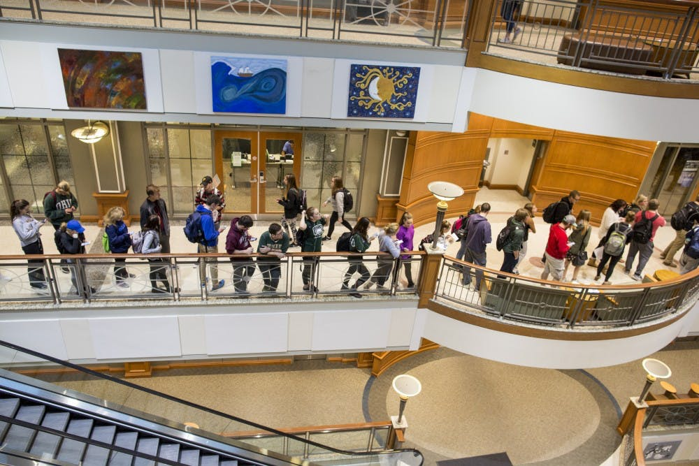 Students wait out long lines to vote in Baker Center