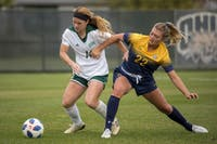 Junior defender Victoria Breeden fights for possession during Ohio's 1-0 loss to Kent State on Thursday, Oct. 25, 2018.