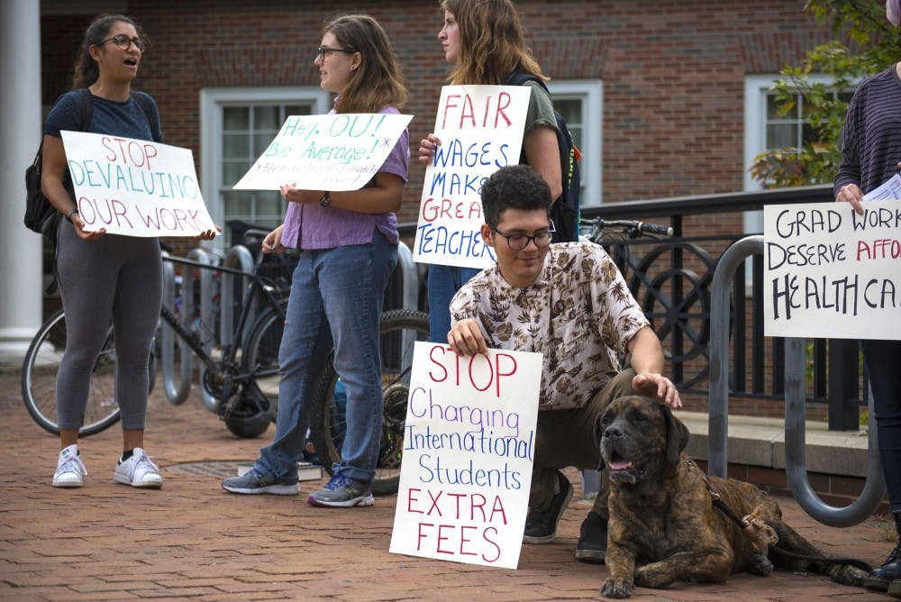 Graduate students protest outside of Baker