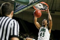 Ohio junior forward Doug Taylor (#45) yells in excitement after a dunk in the second half of the Bobcats' 75-59 win over Bowling Green on Tuesday, Feb. 27.