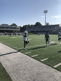 Redshirt junior Cam Odom (No. 3) walks along the sideline before Ohio's practice on Thursday, Aug. 8, 2019.