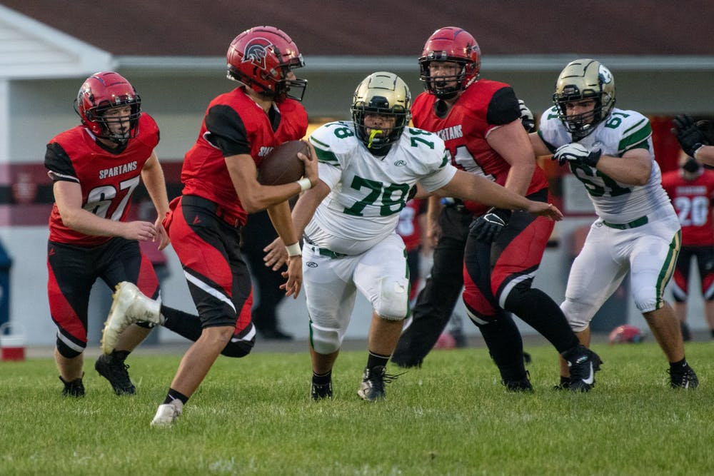 Alexander's Michael Lash II runs the ball during the Athens versus Alexander game on Friday, Aug. 28, 2020, at Alexander High School. Athens won the match 20-13.
