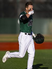 Ohio catcher Tanner Piechnick (#31) gestures to his team as he rounds the bases after hitting a walk-off grand slam during the Bobcats' game on Saturday, March 23 at Bob Wren Stadium.