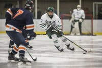 Ohio forward Gianni Evangelisti (#7) skates up the ice with the puck during the third period of the Bobcats' game against Syracuse on Feb. 1.