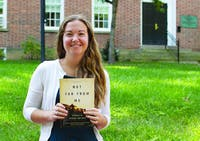 Berkeley Franz poses on College Green with her book Not Far From Me on Tuesday, Sept. 10, 2019.