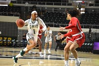 Ohio's Cece Hooks (#1) dribbles past Ball State's Maliah Howard-Bass (#5) during their game on Saturday, Feb. 2.