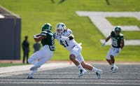 Ohio's Evan Croutch tackles Eastern Michigan's Jason Beck during their game Sept. 23, 2017. (FILE)