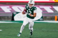 Ohio University quarterback (No. 12) Nathan Rourke running the ball at the homecoming game against Northern Illinois University. Ohio lost 36-39 on Oct. 12, 2019.