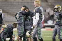 Athens players react after the final whistle of the Division III State Football Championship Game on Dec. 4, 2014. The Bulldogs lost to Toledo Central Catholic 56-52. (FILE)