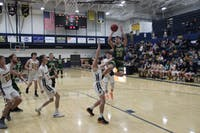 Logan Maxfield goes up for an acrobatic finish Tuesday in Athens 69-23 victory over Wellston to clinch the TVC-Ohio title.