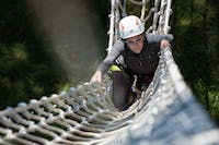 Pamela Gaboury climbs the rope ladder at the Outdoor Pursuits zip line at The Ridges on Sept. 30. (FILE)