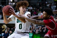 Ohio guard Jason Preston (#0) drives past Miami in the first half of their game on Saturday Feb. 8, 2020.