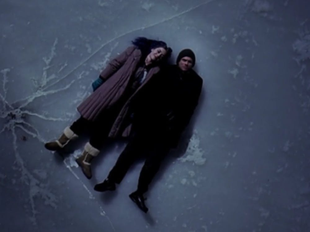 Kate Winslet and Jim Carrey stargazing on the cracked ice of the Charles River in Boston (Photo provided via @AniketKMandal on Twitter)