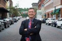 Steve Patterson, the Ohio University professor running unopposed for mayor, poses for a portrait on Court Street. (OLIVER HAMLIN | FOR THE POST)