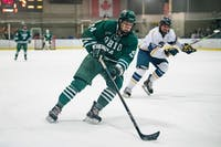 Ohio's Scott Bagby attempts to keep the puck away from Kent State's Mike Sullivan during the Bobcat's match against the Golden Flashes on Friday.