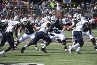 Ohio's offensive line protects the punter from Howard's defensive line. Sept. 1.