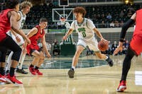 Jason Preston, of Ohio, dribbles the ball during the match versus Rio Grande on Wednesday, December 4, 2019, in The Convo. Ohio won the match 90-51.
