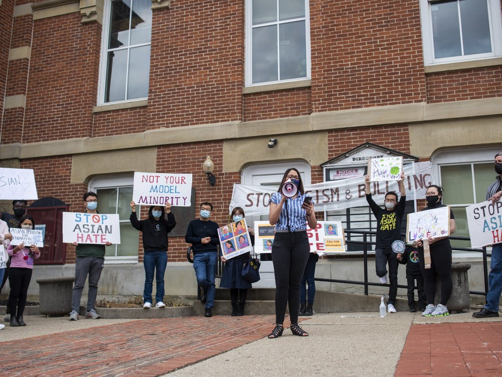 Athens community members gather to rally against Asian hate, due to the recent mass shooting that claimed the lives of multiple Asian women, on March 27, 2021, in Athens, Ohio.