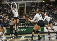 Ohio's Vera Giacomazzi (#6, left) sets a ball for Sara Januszewski (#4, center) and Katie Nelson (#2, right) during the Bobcats' game against Kent State on Sept. 20. (FILE)