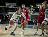 Ohio's Dominique Doseck drives to the basket during the Bobcats' game against Ball State. The Bobcats defeated the Cardinals 80-76.
