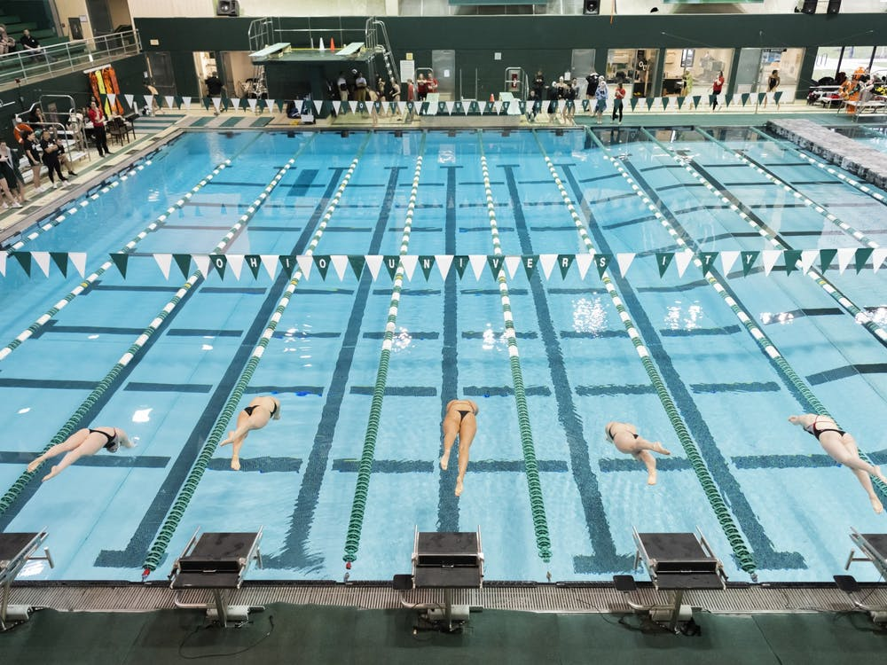 Swimmers do a start during the 400 Individual Medley during the Ohio University vs. Ball State meet at home. Bobcats won against the Cardinals 188.5 to 110.5 on Saturday, Jan. 25th, 2020.
