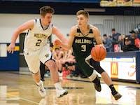 Brody Ball (3) drives to the basket against Wellston High School on January 13th, 2016 STAFF PHOTOGRAPHER|MATT STARKEY