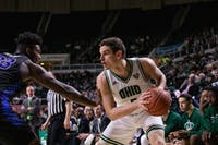 Ohio forward Ben Vander Plas (#5) moves against Buffalo's Nick Perkins (#33) during their game at the Convo.