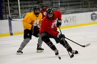 Defenseman Nick Grose stick-handles the puck through defenders during tryouts at Bird Arena on Tuesday, September 11.