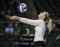 Outside hitter Lizzie Stephens bumps the ball during Ohio's match against Florida Gulf Coast on Aug. 27, 2016. Ohio lost 0-3 to FGCU. (FILE)