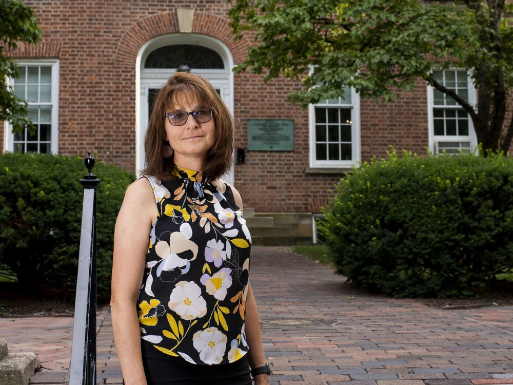 Dr. Gillian Ice poses adjacent to Cutler Hall on July 15, 2021.