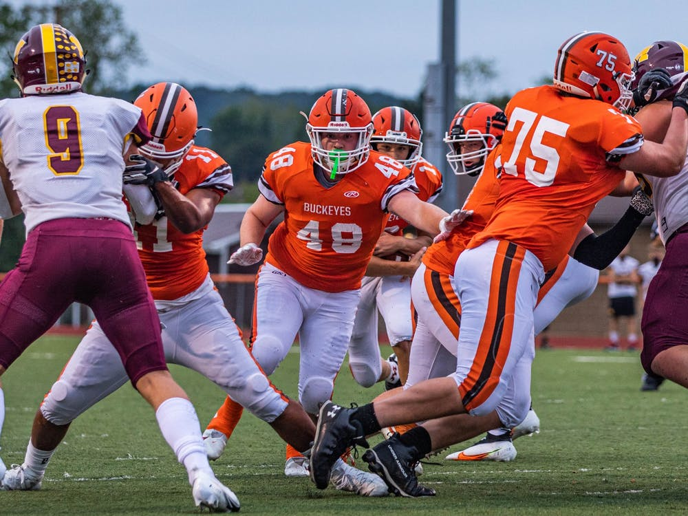The Buckeyes' FB Colton Snyder (#48) pushes through a play against Meigs High School in the first quarter at a match held at Nelsonville-York High School's Boston Field on Friday, Sept. 11, 2020.