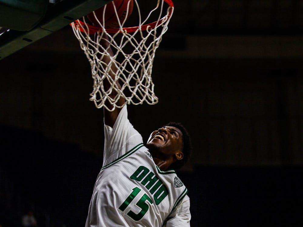 Ohio guard Lunden McDay (No. 15) dunks the ball with only one minute remaining in a match against Central Michigan University at the Convo on Tuesday, Feb. 18, 2020. The Bobcats will end the game in victory with a final score of 77 - 69.