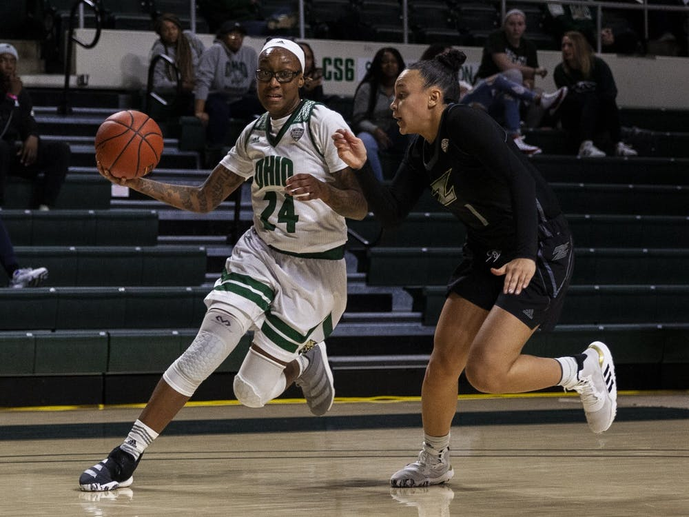 Ohio gaurd Erica Johnson drives toward the basket with pressure from Akron gaurd Kendall Miller during the Bobcat 70-57 victory in the Convo on Wednesday, Jan. 29, 2020. (FILE)
