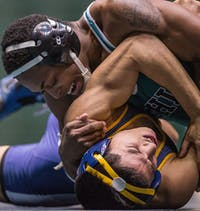 Ohio University sophomore Kevon Powell pins Kent State University sophomore Edilberto Vinas to the mat. The Bobcats defeated the Golden Flashes 21-16 for the first time since 2005 during their meet held at The Convocation Jan. 24, 2014.