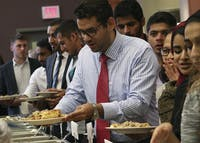 Attendants at the annual International Dinner, hosted by Ohio University's International Student Union, are served international cuisine in Baker Ballroom on Oct. 1st, 2017. (FILE)