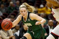 Ohio senior guard Taylor Agler (#0) drives to the basket during the second half of the Bobcats' 69-66 loss to Miami in the quarterfinals of the MAC Tournament on Wednesday, March 7..