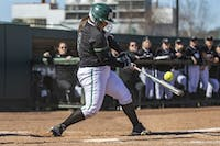 Ohio infielder Morgan Geno (#9) hits the ball in extra innings during the Bobcats game against Bowling Green on Friday, March 23, 2019, in Athens, Ohio. The Bobcats won the second game of the series against the Flacons 8-7 in extra innings.