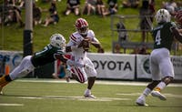 Ohio University safety, Javon Hagan (#7), attempts to tackle University of Louisiana's quarterback, Levi Lewis (#1), during the bobcats home game on Saturday, Sept. 21, 2019. (FILE)