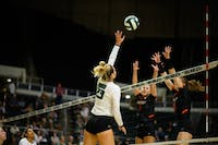 Ohio University hitter, Maggie Nedoma (#23), tips the ball at the game against Bowling Green University on Friday, Sept. 27 in Athens, Ohio.