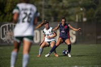 Ohio University's Victoria Breeden (#14) and Robert Morris' Kayla Veloso-Lima (#19) battle it out for a ball during the Bobcats' home game on Friday, Sept. 13, 2019. (FILE)