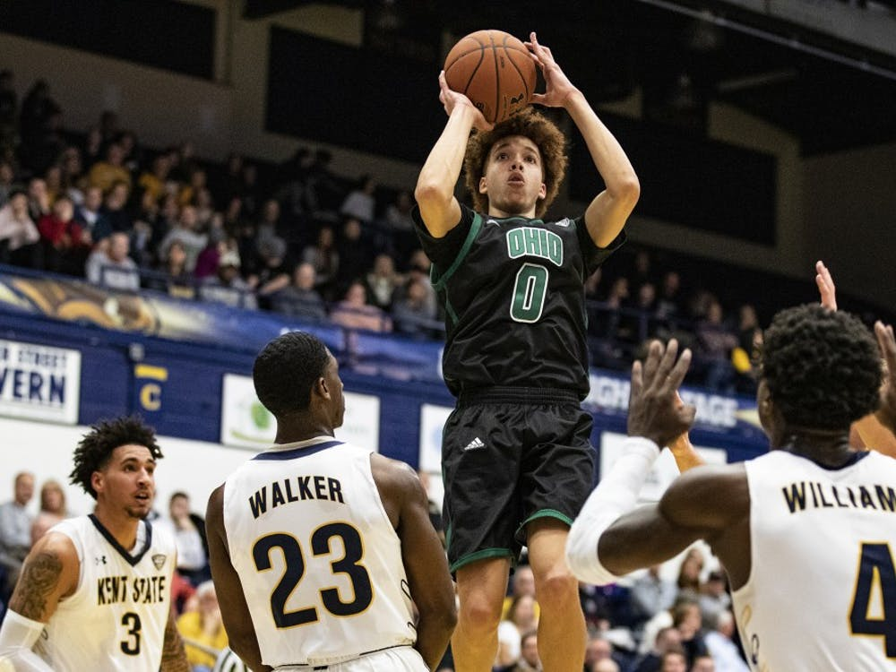 Ohio guard Jason Preston (#0) attempts a shot while Jaylin Walker (#23) of Kent State defends Preston during the game at the Memorial Athletic and Convocation Center in Kent, Ohio on Feb. 26. 2019. (FILE)