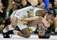 Ohio University's Shakur Laney pins down American University's Josh Terao during Ohio's match Sunday.