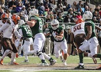 Running back A.J. Ouellette (#45) running a ball between Bowling Green defenders during Ohio's 49-14 win Saturday.