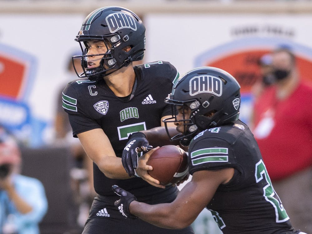 Ohio quarterback Kurtis Rourke (#7) hands off the ball to De'Montre Tuggle (#24) during the Bobcats' game against Syracuse on Saturday, Sep. 4, 2021.