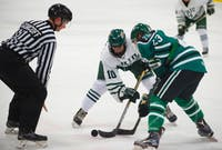 Senior forward Bryan Lubin (#10) handles the puck during a faceoff in Ohio's game against Eastern Michigan on Oct. 13. The Bobcats won 8-1. (FILE)