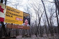 """A billboard for the fake """"Margie's Meatloaf Mecca"""" business sits off of Route 33."""